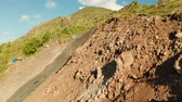 landslide : Workers strengthen the slope of the mountain with metal mesh preventing rockfall and landslide on the road, above view. workers constructing anti-landslide concrete wall prevent protect against rock slides. safety concept Stock Footage