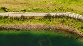 путь : Winding coastal road that runs along Bay near turquoise sea. road along the coast near ocean, aerial view. Summer and travel vacation concept