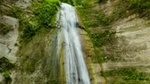 dao : Beautiful waterfall in green forest. Tropical Dao Falls in mountain jungle, Philippines, Cebu. Waterfall in the tropical forest.