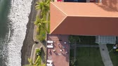 benen : aerial view people do fitness on roof hotel by sea in tropical resort. People play sports and fitness.