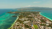 zátoka : Costline of the tropical island of Boracay with sandy beaches and hotels from above. Summer and travel vacation concept. Philippines. Dostupné videozáznamy