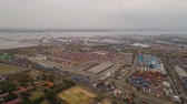 scheepvaart : aerial view container terminal port surabaya. cargo industrial port with containers, crane. Tanjung Perak, indonesia. logistic import export and transport industry Stockvideo