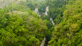 dao : Aerial view of Dao waterfalls in a mountain gorge in the tropical jungle, Philippines, Cebu. Waterfall in the tropical forest.