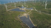 bangui : Aerial view wind turbines for electric power production on the seashore. Bangui Windmills in Ilocos Norte, Philippines. Solar farm, Solar power station. Ecological landscape: Windmills, sea, mountains.Pagudpud.