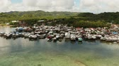 kůlna : Fishing village with boats and slums with wooden houses, aerial drone. Dapa, Siargao, Philippines.