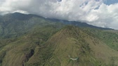 falésias : Aerial view mountains covered forest, trees against sky and clouds.Cordillera region. Luzon, Philippines. Mountainous tropical landscape.
