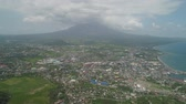 picos : Aerial view city Legazpi against Mayon volcano. Tropical landscape city near volcano on seashore, Philippines, Luzon.