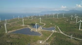 solarstrom : Aerial view of wind turbines for electric power production on the seashore. Bangui Windmills in Ilocos Norte, Philippines. Solar farm, Solar power station. Ecological landscape: Windmills, sea, mountains.