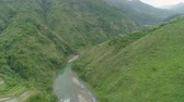 falésias : Aerial view mountain river in cordillera gorge, mountains covered forest, trees. Cordillera region. Luzon, Philippines. Mountain landscape in cloudy weather.