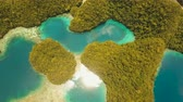 turkuaz : aerial footage lot islands in lagoon with turquoise water Bucas Grande Island Sohoton Cove. islands covered with green tropical forest surrounded by beautiful bays and lagoons tropical seascape blue sea, azure lagoon. Flying over the azure surface ocean.
