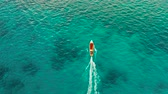 watercraft : Speed boat on the surface of the lagoon with turquoise water, aerial view. Summer and travel vacation concept. Balabac, Palawan, Philippines.
