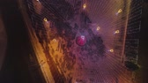 Рождество : town square and Christmas tree decorated with illumination, view from above. Large Christmas garland lamps. Стоковые видеозаписи