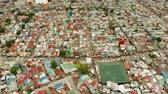지저분한 : Poor district and slums with shacks in a densely populated area of Manila aerial view. 무비클립