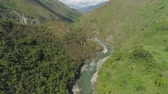 valle : Aerial view mountain river in cordillera gorge, mountains covered forest, trees. Cordillera region. Luzon, Philippines. Mountain landscape. Archivo de Video