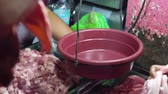 butchers : Butcher weighs raw meat on scales for sale at a street market. Stock Footage