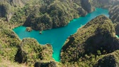 busuanga : Aerial drone Kayangan lake with blue water on tropical island Coron. Lake in the mountains covered with tropical forest. Palawan, Philippines Stock Footage
