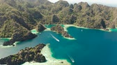busuanga : Aerial drone tourist boats around the beautiful big and small lagoons. lagoon, mountains covered with forests.coves with blue water among the rocks. Seascape, tropical landscape. Palawan, Philippines