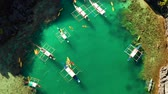 falésias : aerial view of tourist boats over tropical lagoon and coral reef. Small lagoon with turquoise water. El nido, Philippines, Palawan. Summer and travel vacation concept.