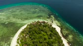 view from above : Beautiful beach on tropical island surrounded by coral reef, top view. Mantigue island. Small island with sandy beach. Summer and travel vacation concept, Camiguin, Philippines, Mindanao