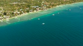 sailboat : Shore with hotels near coral reef and diving boats, Moalboal, Philippines. Aerial view, Summer and travel vacation concept. Stock Footage