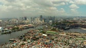 grue tour : Cityscape of Makati with sea port,the business center of Manila, view from sea. Asian metropolis. Travel vacation concept.