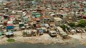 manila : Slums in Manila near the port. River polluted with plastic and garbage. Manila, Philippines. Stock Footage