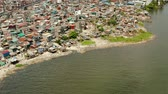 urban waste : Slum area in Manila, Phillippines, top view. lot of garbage in the water.