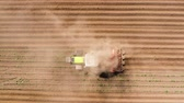 farming equipment : Tractor Hilling Potatoes with disc hiller in a potato field aerial view. Farmers preparing land and fertilizing Stock Footage