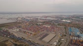 クレーン : aerial view container terminal port surabaya. cargo industrial port with containers, crane. Tanjung Perak, indonesia. logistic import export and transport industry 動画素材