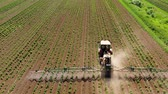 farming equipment : Tractor spraying glyphosate pesticides on farm field from above.Tractor with pesticide fungicide insecticide sprayer on farm land.