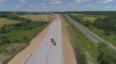 cantiere edile : Construction of toll roads in rural areas. Aerial view construction of a new highway next to the old highway.