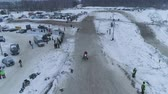 крайняя местности : Russia, Championship on snowmobiles January 27, 2018: Winter racing on snowmobiles. Aerial view: Snowmobile on the route in a jump. Action from snowmobile races.
