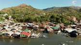 오두막 : Old wooden house standing on the sea in the fishing village. Busuanga, Coron, Philippines. houses community standing in water in fishing village. Coron city with slums and poor district.