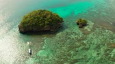 turkus : Turquoise lagoon with rocky island and corall reef, aerial view Boracay, Philippines. Summer and travel vacation concept. Wideo
