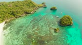 入り江 : Turquoise lagoon with rocky island and corall reef, aerial view Boracay, Philippines. Summer and travel vacation concept. 動画素材