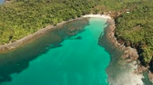 入り江 : aerial view tropical sandy beach with coral reef and blue lagoon surrounded by rainforest. Palawan, Philippines. tropical landscape. Seascape island and clear blue water. Summer and travel vacation co