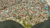 Slums with shacks of local residents and the river bank littered with garbage from above. Manila, Philippines. Wideo