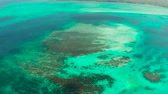 Turquoise lagoon surface on atoll and coral reef, copy space for text. Top view transparent turquoise ocean water surface. background texture