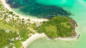 A lagoon with a coral reef and a white sandy beach, a view from above. The coast of a tropical island. Summer and travel vacation concept. Caramoan Islands, Philippines. Wideo