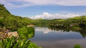 subúrbio : Tropical landscape in sunny weather. Village by the river. Green hills and river. Summer and travel vacation concept. The nature of the Philippine Islands.