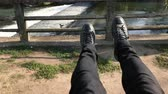 Personal perspective of feet while in a swing Стоковые видеозаписи