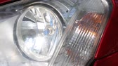 halogen headlamp : Flashing headlights turn on a red modern car