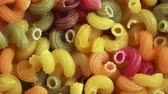 makaróny : a lot of raw multicolored pasta as a background