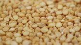 small bowls : dry yellow peas close-up as background. preparation of nutritious dishes from legumes Stock Footage