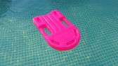 cankurtaran : pink plastic rescue buoy in the pool with clean water