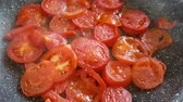 rebuliço : cut into slices tomatoes are stewed in a frying pan. preparation of tomato sauce