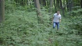 trough : Two men chasing trough the woods Stock Footage