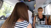Passengers takes the seats on the tour bus, family vacation on summer time Стоковые видеозаписи