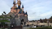 PARIS, FRANCE - December 30, 2016: Entertainment resort Disneyland Paris with view to the Sleeping Beauty Castle and crowd of visitors. It is is the most visited theme park in all of France and Europe