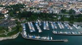 Aerial View of Yachts and Boats in a Marina on Bodensee lake in Friedrichshafen. Cityscape in the background in Germany